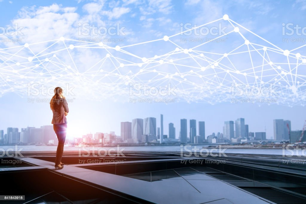 young business woman and mesh communication network concept. IoT(Internet of Things). ICT(Information Communication Network). Smart city. abstract mixed media. stock photo