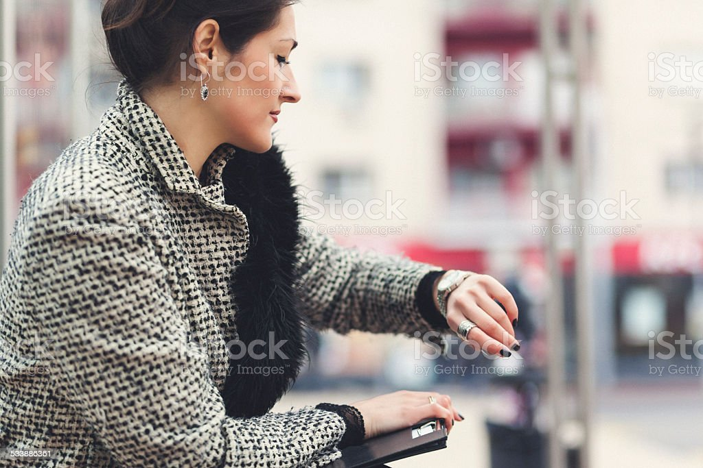 Young business woman at bus station stock photo