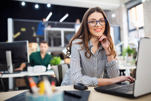 Young business woman at her workplace Young designer working at her office. project manager stock pictures, royalty-free photos & images