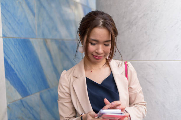 Young business woman checking message on smart phone stock photo