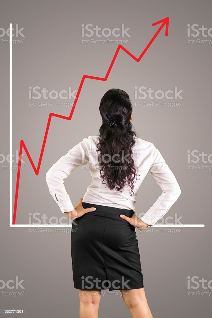 Young business woman checking the upward graph stock photo