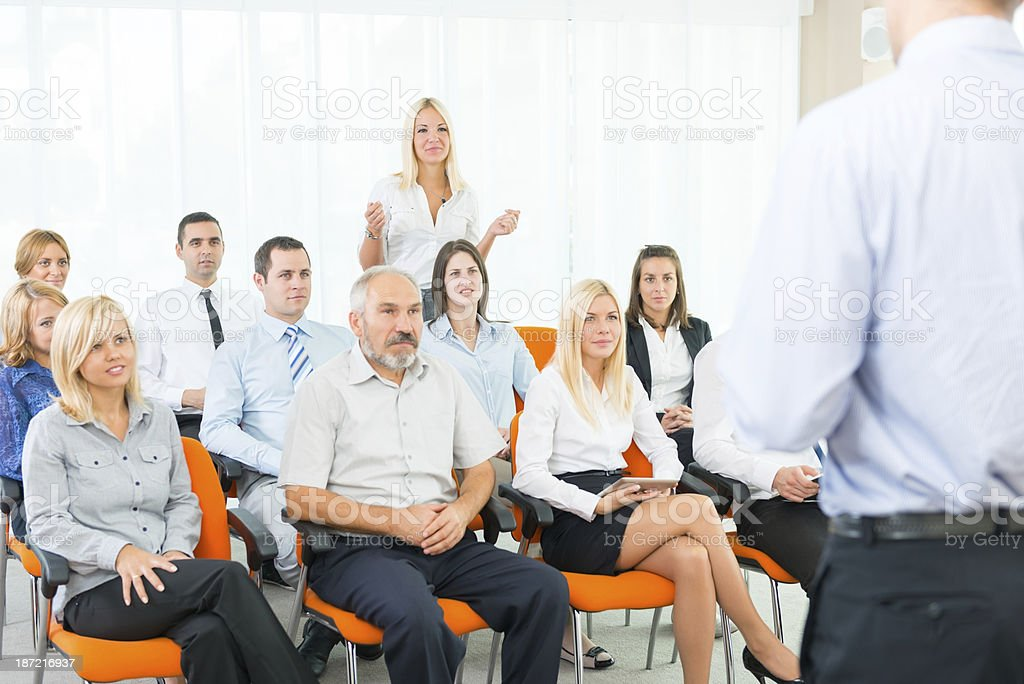 Young business woman debate at the seminar royalty-free stock photo