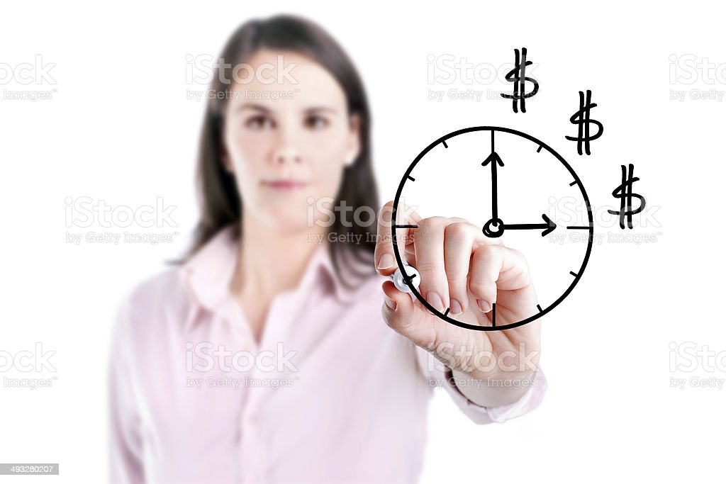 Young business woman drawing a time on whiteboard. stock photo