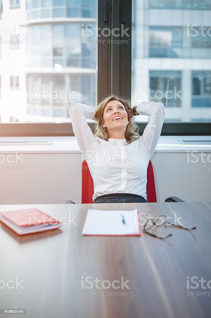 Young business woman dreaming on work stock photo