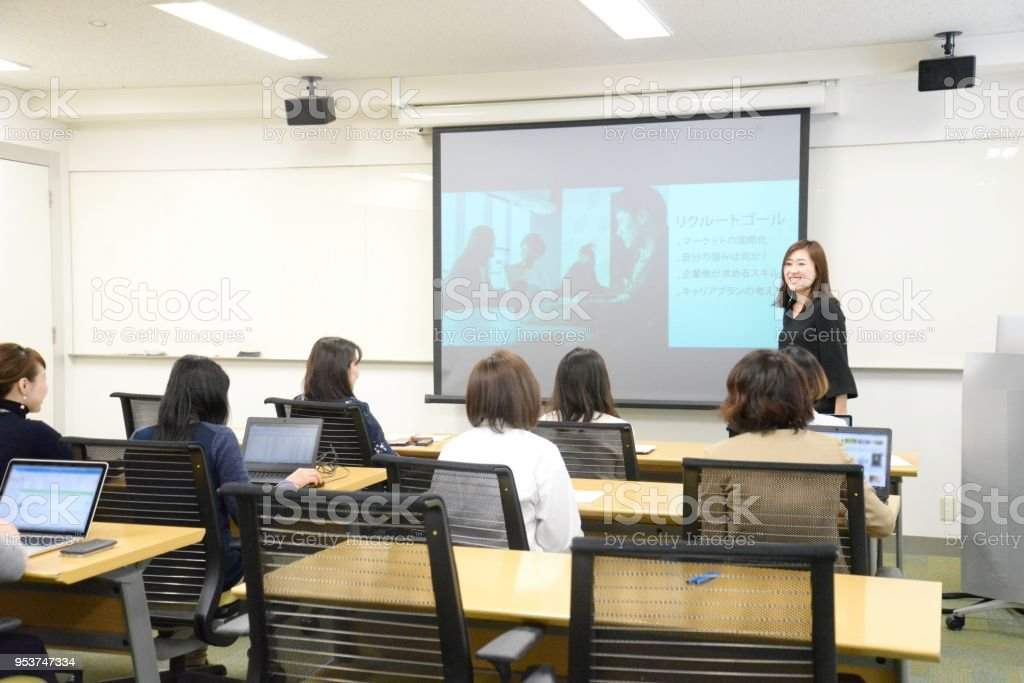 Young business woman giving a presentation stock photo