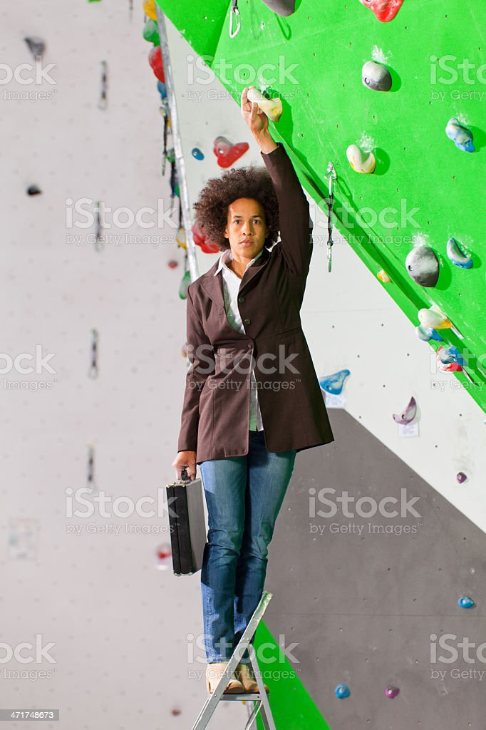 young business woman hanging at wall, beautiful girl royalty-free stock photo