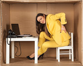 Young business woman has back pain from a bad office chair