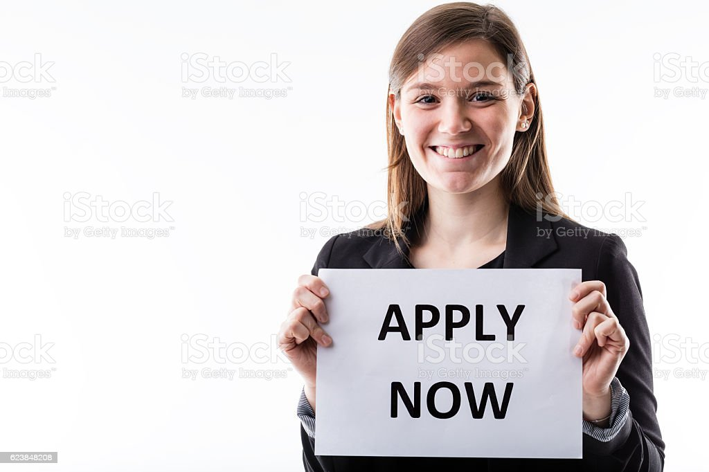 young business woman holding an apply now sign stock photo