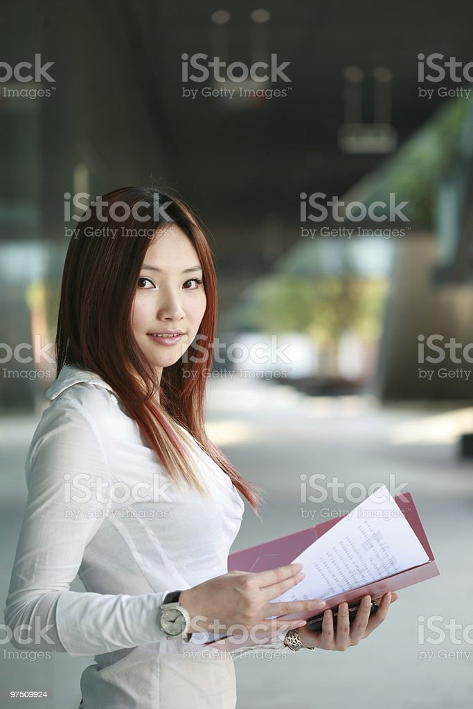 young business woman holding document royalty-free stock photo