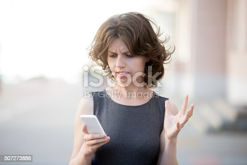 824614192 istock photo Young business woman irritated with her phone 507273886