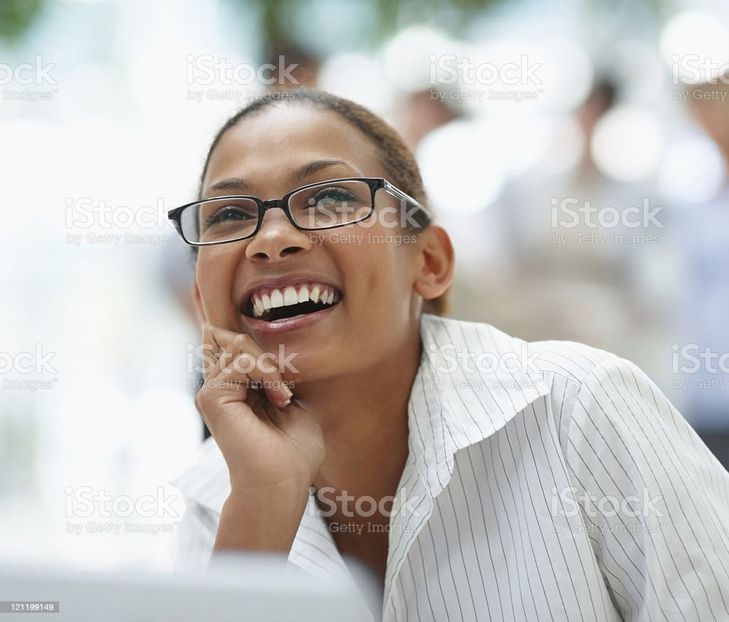 Young business woman laughing over a thought royalty-free stock photo
