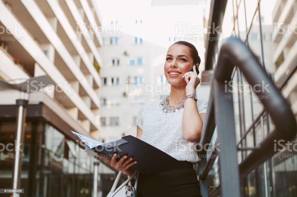 Young business woman outside on the phone stock photo