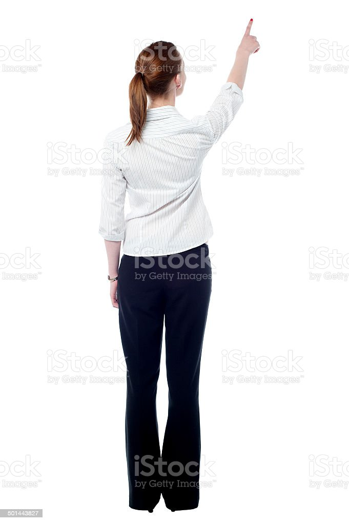 Young business woman pointing at wall - Royalty-free Adult Stock Photo