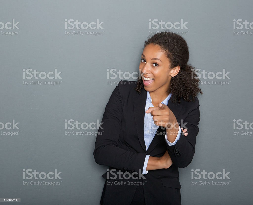 Young business woman pointing finger at you stock photo