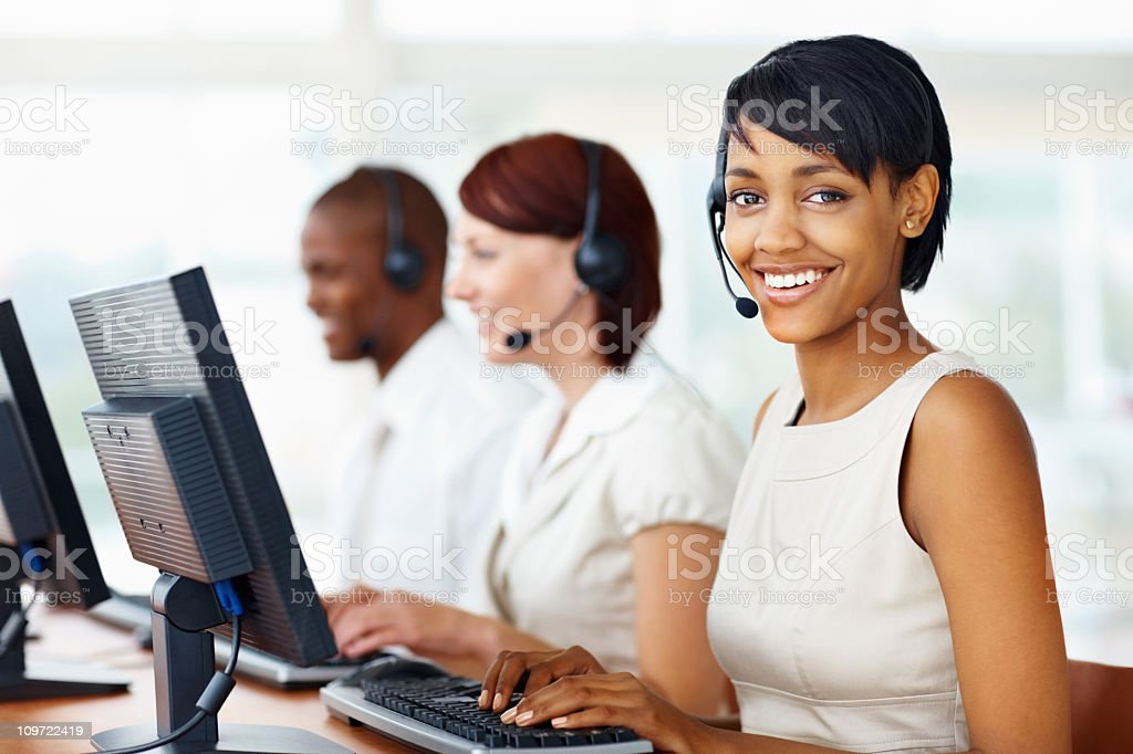Young business woman poses for photo in call center stock photo