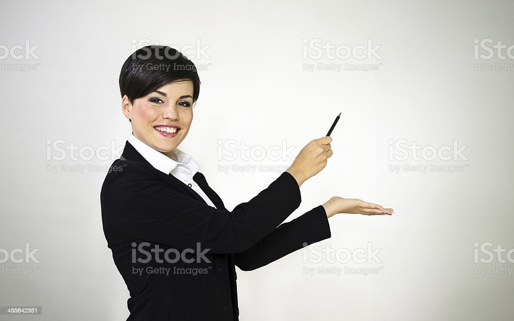 Young business woman presenting with pencil royalty-free stock photo