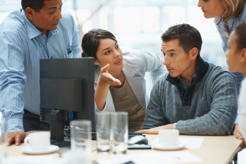 Young Business Woman Presents Ideas To Her Team Stock Photo - Download Image Now
