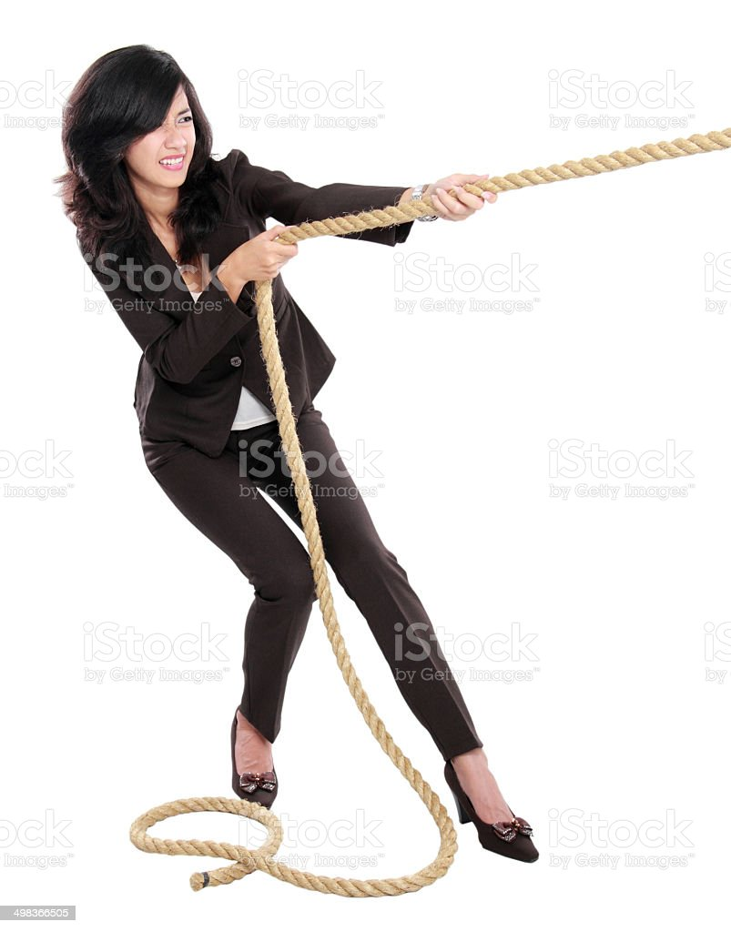 Young business woman pulling a rope stock photo