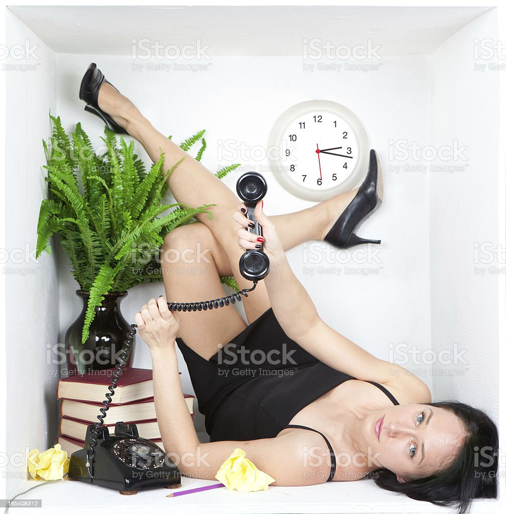 Young business woman secretary laying trapped in cubicle stock photo