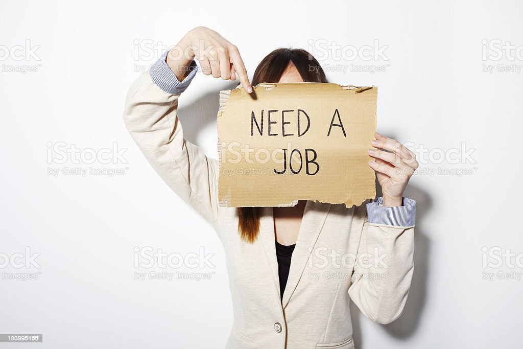 Young business woman showing poster that says need a job royalty-free stock photo