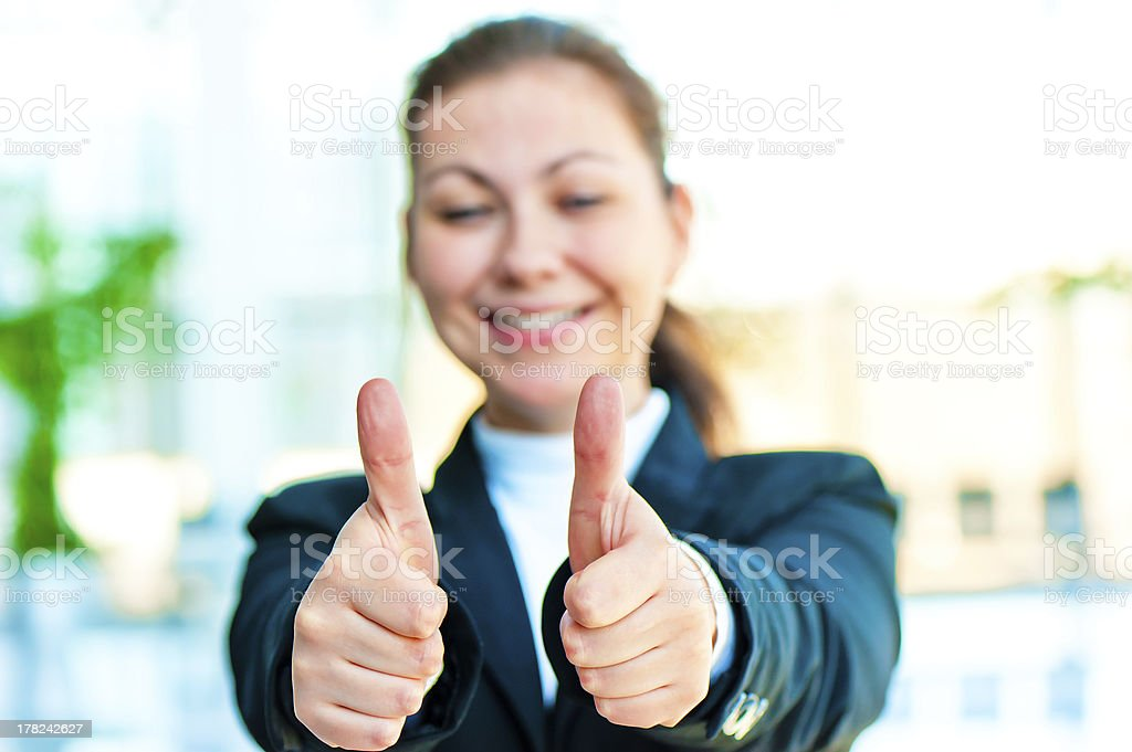 Young business woman shows that everything is fine royalty-free stock photo