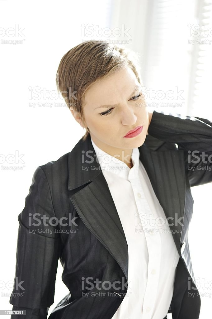 Young business woman suffering from severe neck pain royalty-free stock photo