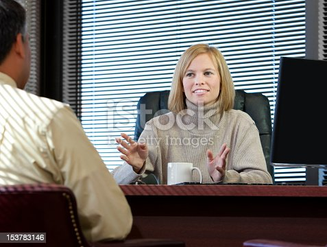 istock Young Business Woman Talking To Co-Worker 153783146