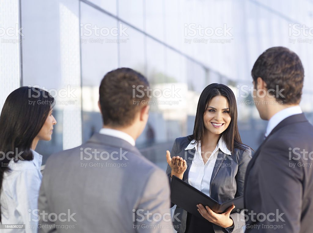 Young business woman talking with colleagues royalty-free stock photo