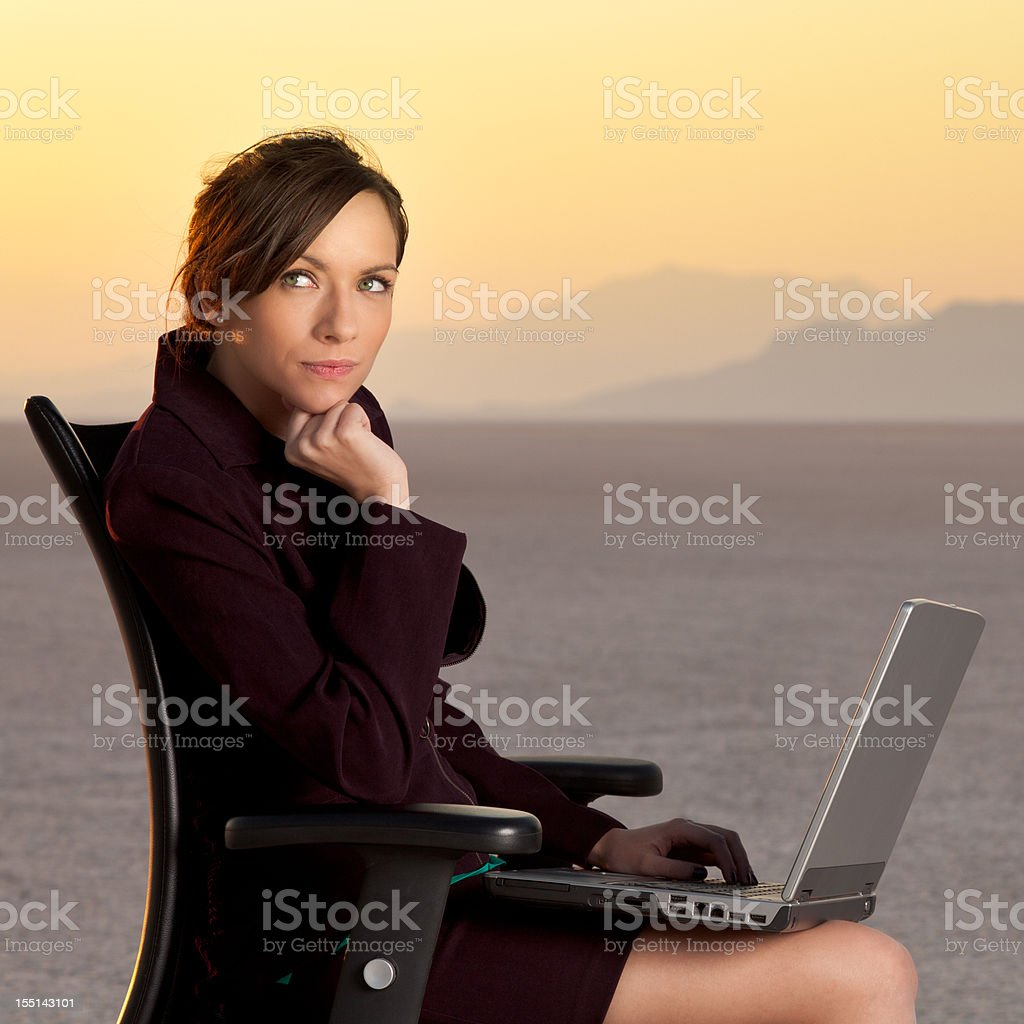 Young business woman thinking in the desert royalty-free stock photo