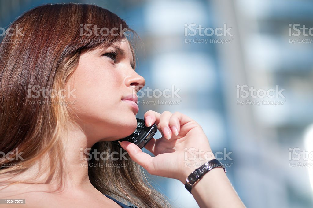 Young business woman using cell phone royalty-free stock photo