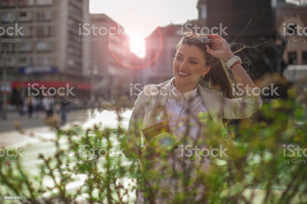 Young business woman using tablet in the city royalty-free stock photo