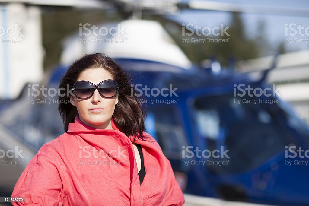 Young business woman waiting for flight with helicopter royalty-free stock photo