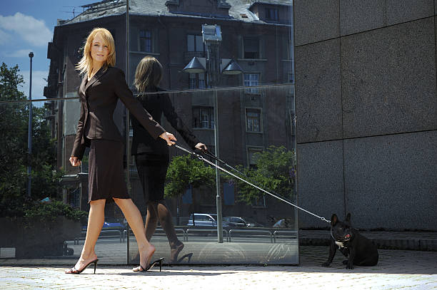 Young business woman walking with a dog picture id106411190?b=1&k=6&m=106411190&s=612x612&w=0&h=u9b6 yo6ymlkxd sxq0eea9qrdgyn6ejn 246kj48cc=