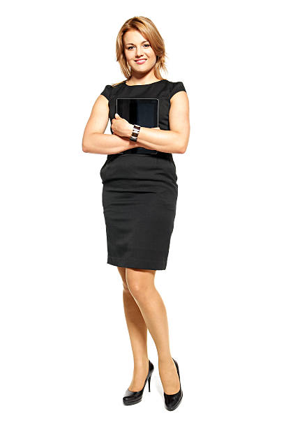 A young business woman wearing a suit Studio shot of attractive  woman in a black dress. Portrait of businesswoman isolated on white background. air stewardess stock pictures, royalty-free photos & images