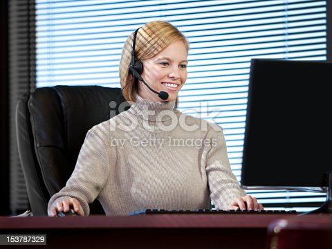 istock Young Business Woman Wearing Headset 153787329