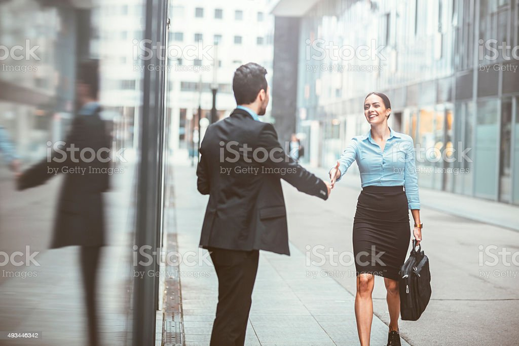 young business woman with a colleague in the business district stock photo