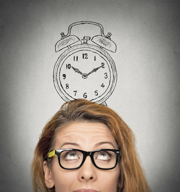 young business woman with alarm clock drawing sketch above her head stock photo