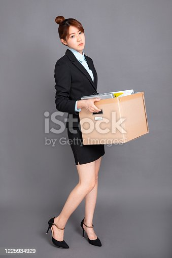 1181817161 istock photo Young business woman with cardboard box being fired 1225934929