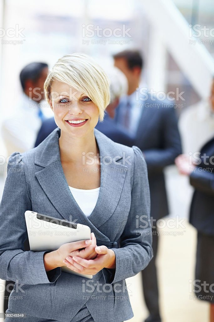 Young business woman with executives in the background royalty-free stock photo