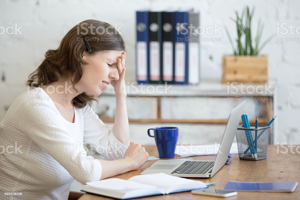 Young business woman with headache stock photo