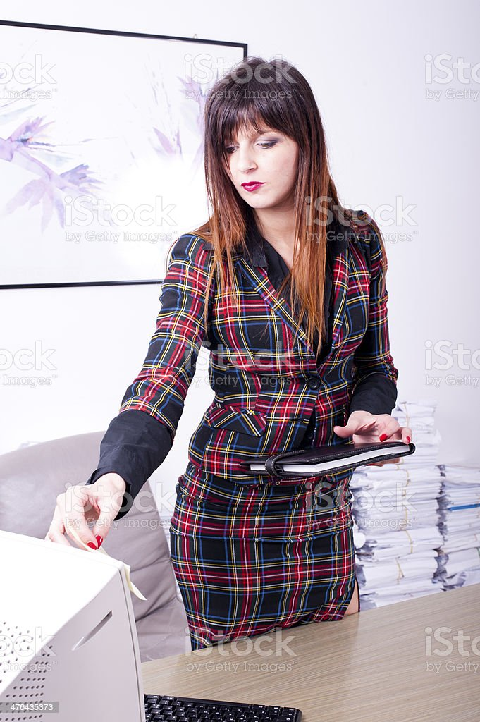 Young business woman with jacket holding notepad in studio royalty-free stock photo