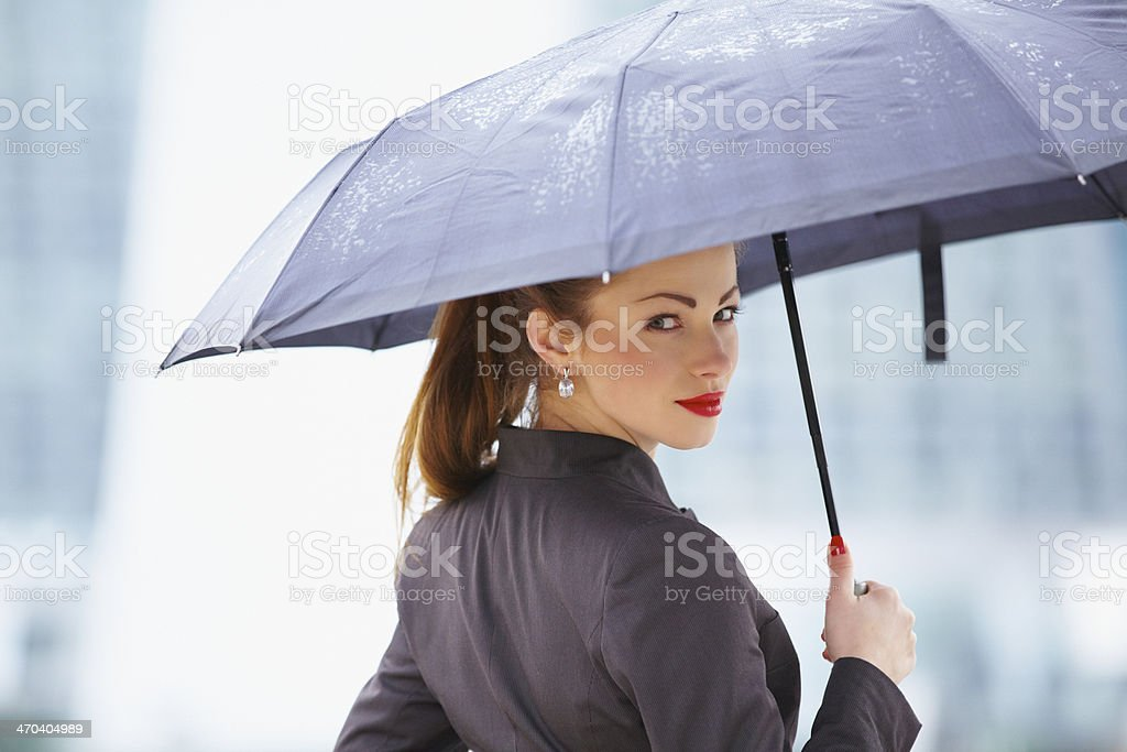 Young business woman with umbrella stock photo