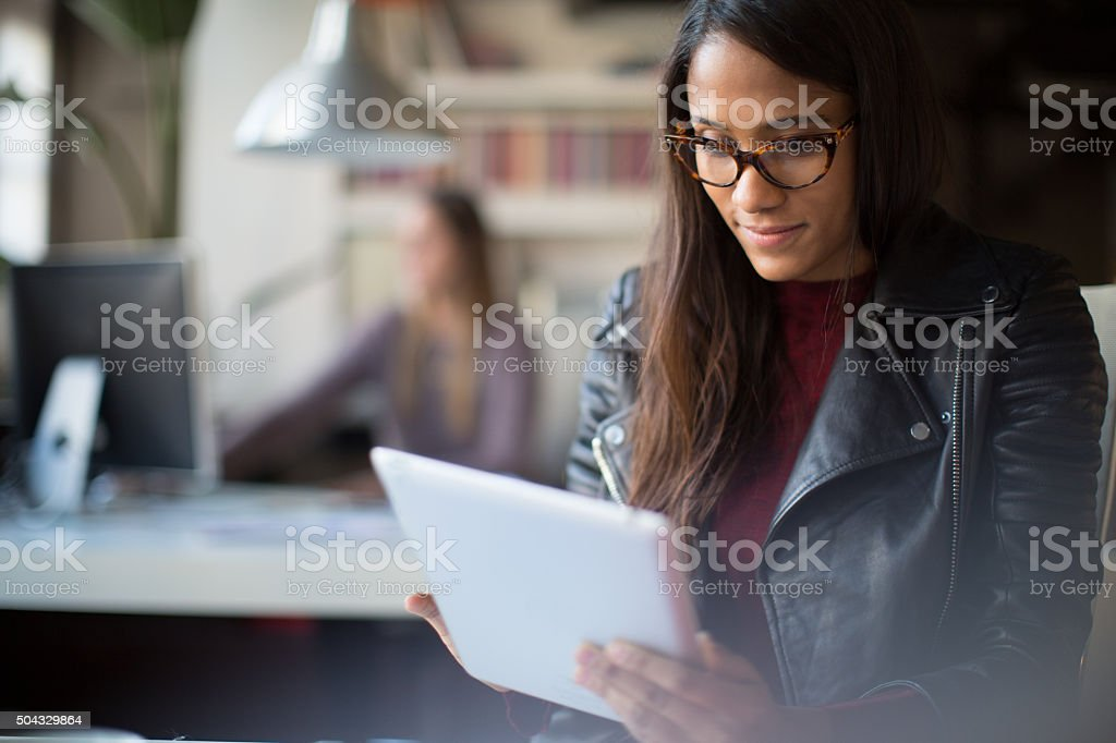 Young business woman working with a digital tablet. stock photo