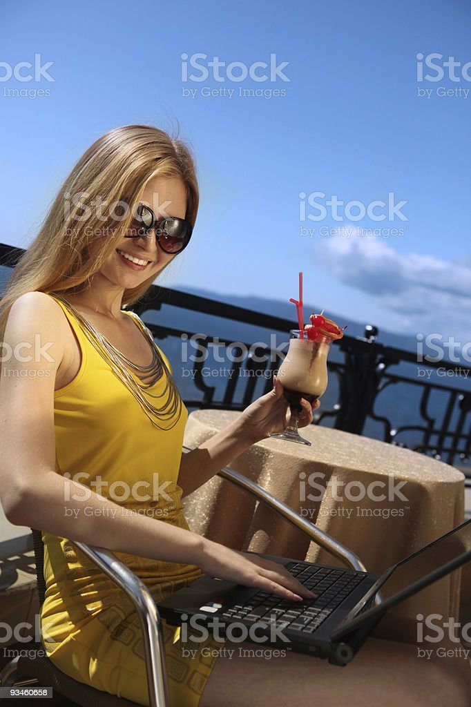 Young business woman working with laptop on the balcony. royalty-free stock photo
