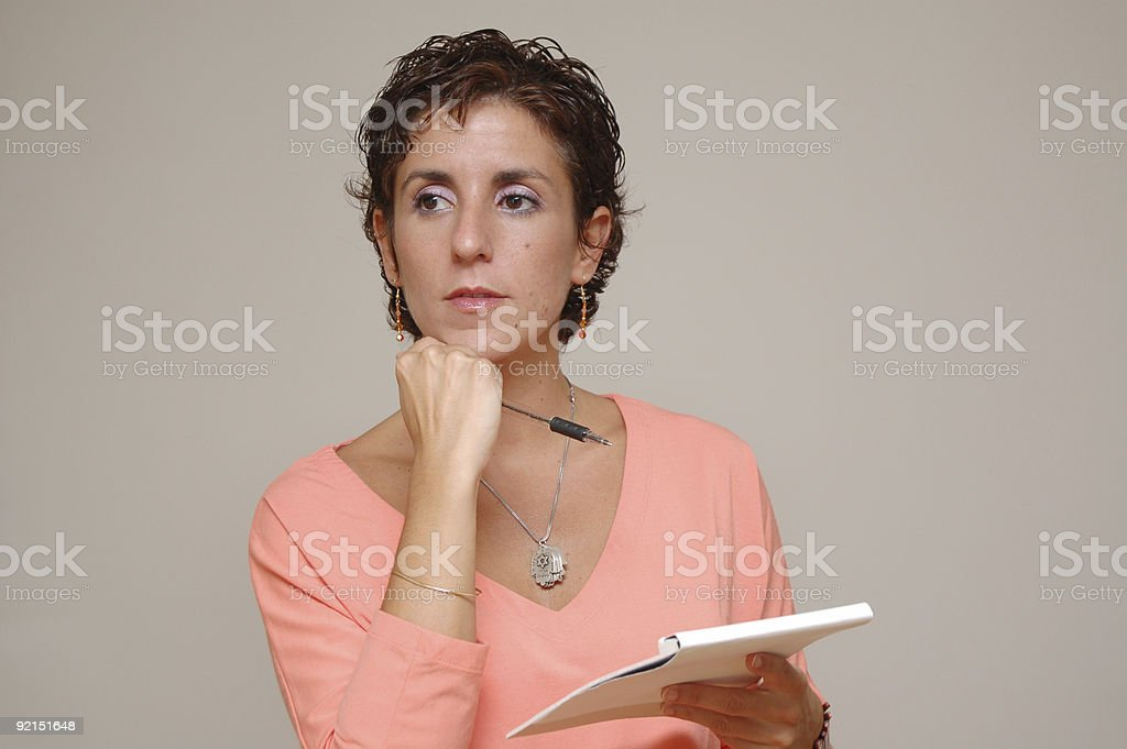 Young business womand with pen and notebook royalty-free stock photo