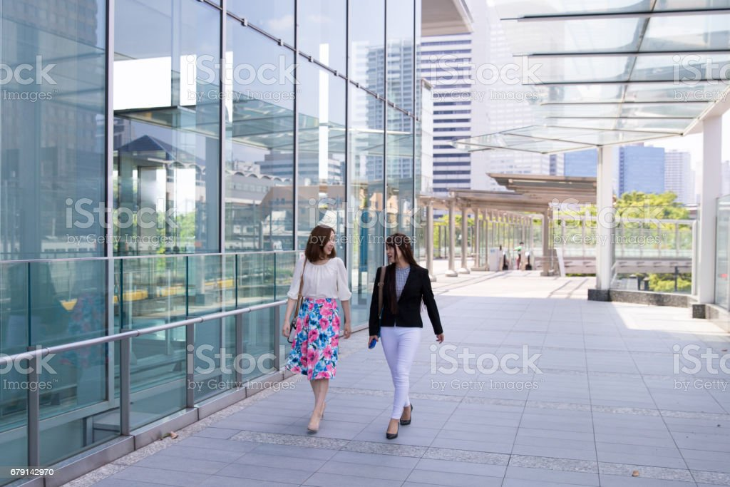 Young business women going to office together in the morning stock photo