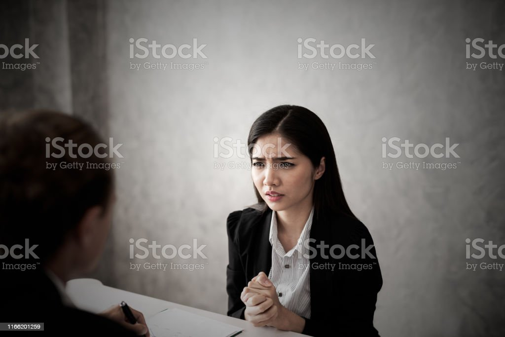 Young business women in black suit are stressed. Boss complaints at...