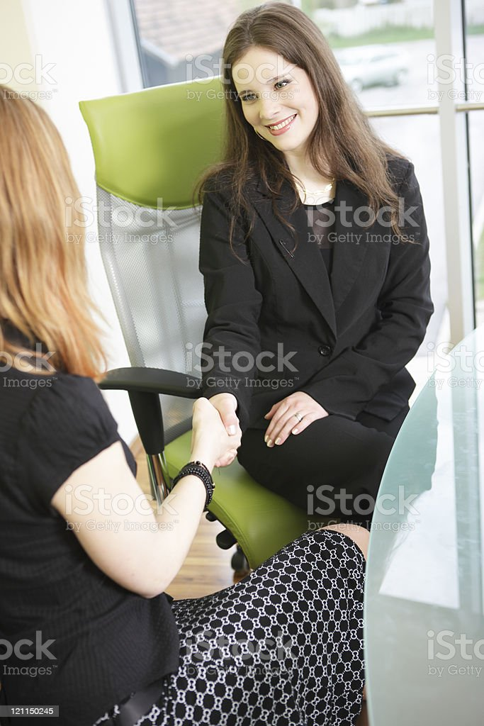 Young business women shake hands royalty-free stock photo