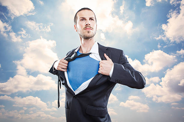 Young businessman acting like a super hero Young businessman acting like a super hero and tearing his shirt off undressing stock pictures, royalty-free photos & images