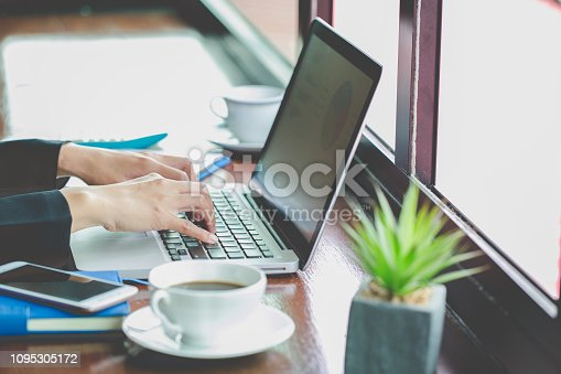 istock Young Businessman Analyzing Graph On Computer At Workplace 1095305172